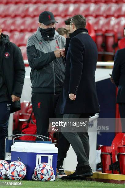 Jurgen Klopp Manager of Liverpool greets Brian Priske Head Coach of FC Midtjylland prior to the UEFA Champions League Group D stage match between...