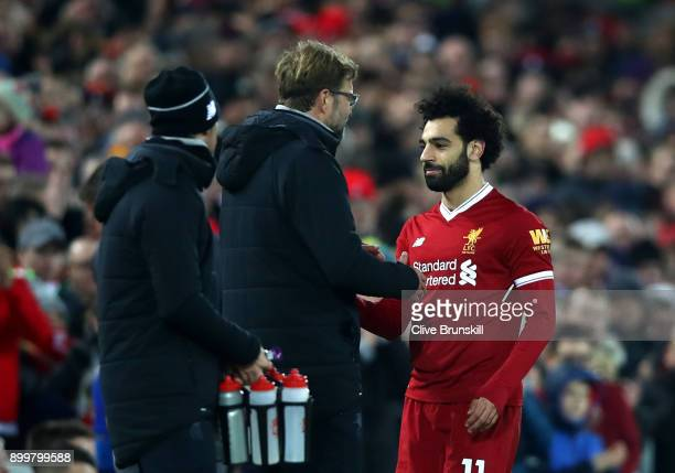 Jurgen Klopp Manager of Liverpool greets Mohamed Salah of Liverpool after he is substituted off during the Premier League match between Liverpool and...