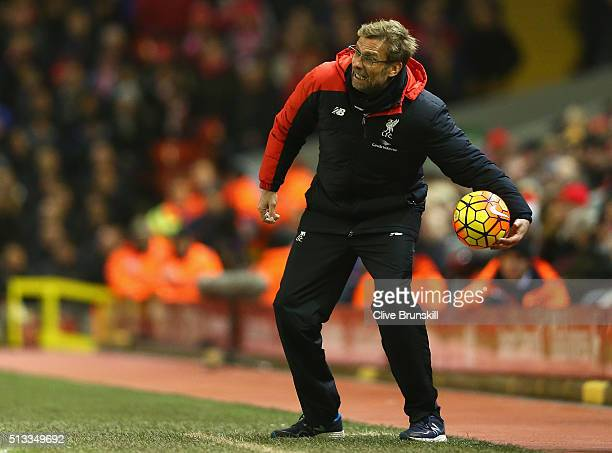 Jurgen Klopp manager of Liverpool holding the match ball during the Barclays Premier League match between Liverpool and Manchester City at Anfield on...