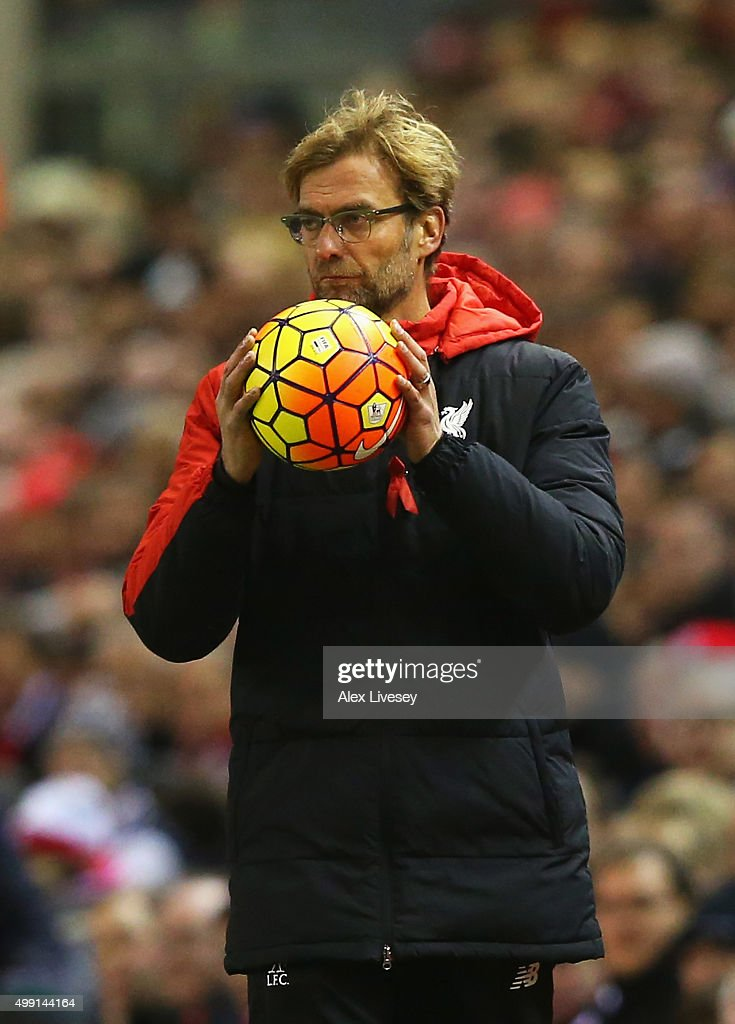 Jurgen Klopp manager of Liverpool holds the match ball during the Barclays Premier League match between Liverpool and Swansea City at Anfield on November 29, 2015 in Liverpool, England.