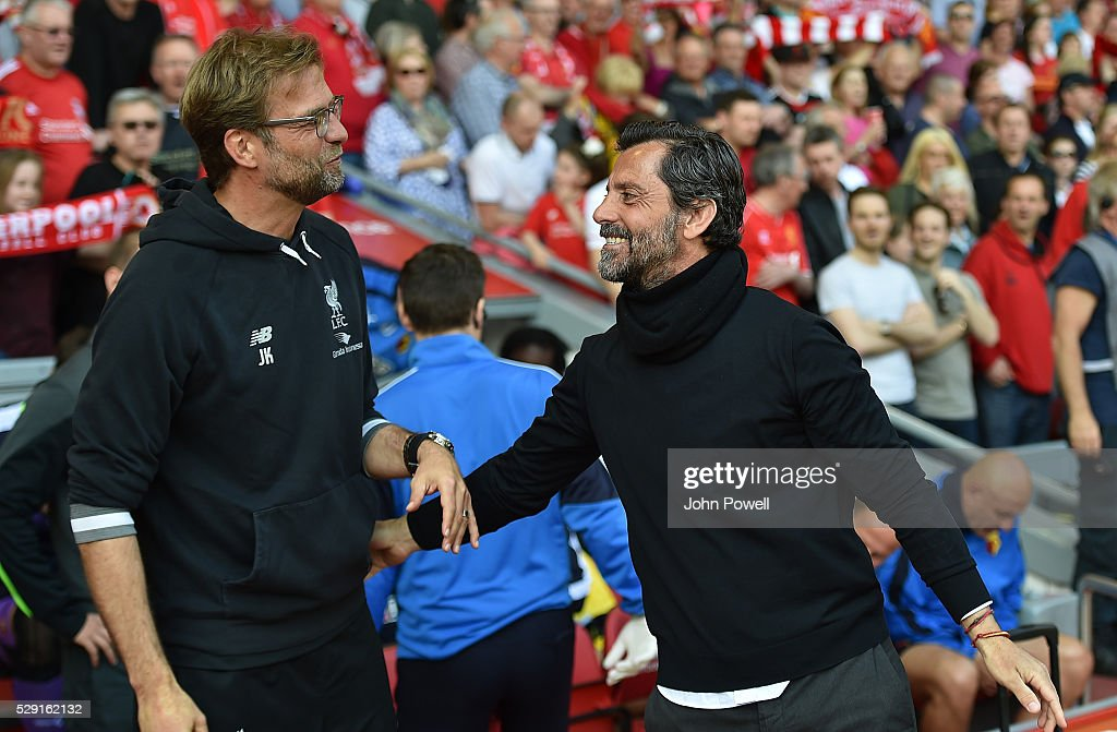 Jurgen Klopp manager of Liverpool hugs and shakes hands with Quique Sanchez Flores manager of Watford before the Barclays Premier League match between Liverpool and Watford at Anfield on May 08, 2016 in Liverpool, England.
