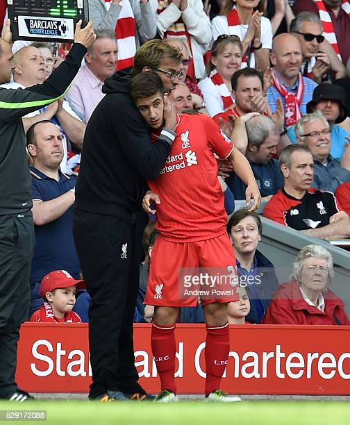 Jurgen Klopp manager of Liverpool hugs Cameron Brannagan of Liverpool as he is substituted during the Barclays Premier League match between Liverpool...