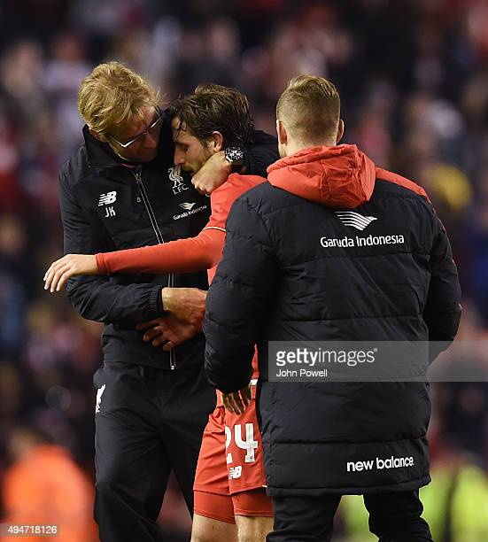 Jurgen Klopp manager of Liverpool hugs Joe Allen of Liverpool at the end of the Capital One Cup Fourth Round match between Liverpool and AFC...