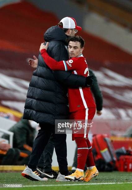 Jurgen Klopp, Manager of Liverpool hugs Xherdan Shaqiri as he is substituted during the Premier League match between Liverpool and Manchester United...