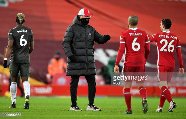 Jurgen Klopp, Manager of Liverpool interacts with Andrew Robertson after the Premier League match between Liverpool and Manchester United at Anfield...