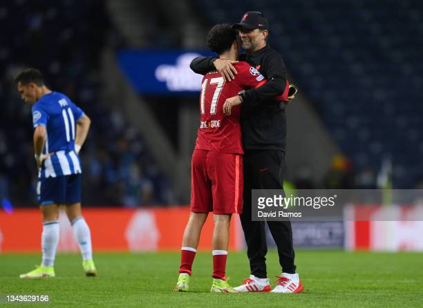 Jurgen Klopp, Manager of Liverpool interacts with Curtis Jones of Liverpool after the UEFA Champions League group B match between FC Porto and...