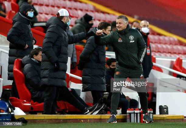 Jurgen Klopp, Manager of Liverpool interacts with Ole Gunnar Solskjaer, Manager of Manchester United during the Premier League match between...