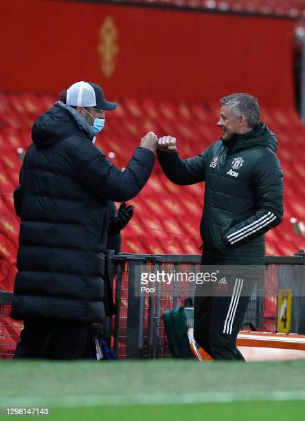 Jurgen Klopp, Manager of Liverpool interacts with Ole Gunnar Solskjaer, Manager of Manchester United ahead of The Emirates FA Cup Fourth Round match...