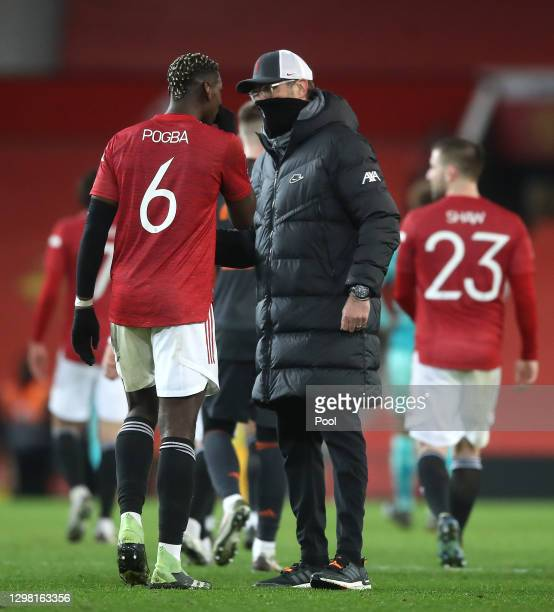 Jurgen Klopp, Manager of Liverpool interacts with Paul Pogba of Manchester United following The Emirates FA Cup Fourth Round match between Manchester...