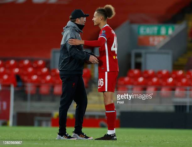 Jurgen Klopp Manager of Liverpool interacts with Rhys Williams of Liverpool after the UEFA Champions League Group D stage match between Liverpool FC...