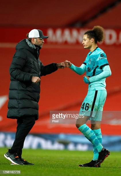Jurgen Klopp, Manager of Liverpool interacts with Rhys Williams of Liverpool following The Emirates FA Cup Fourth Round match between Manchester...
