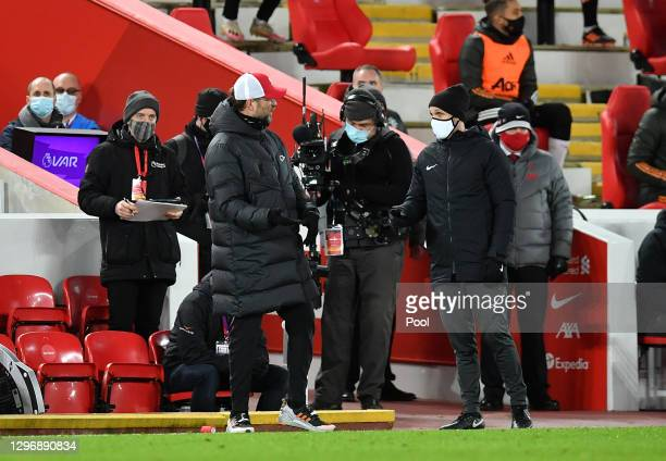 Jurgen Klopp, Manager of Liverpool interacts with the Fourth Official during the Premier League match between Liverpool and Manchester United at...