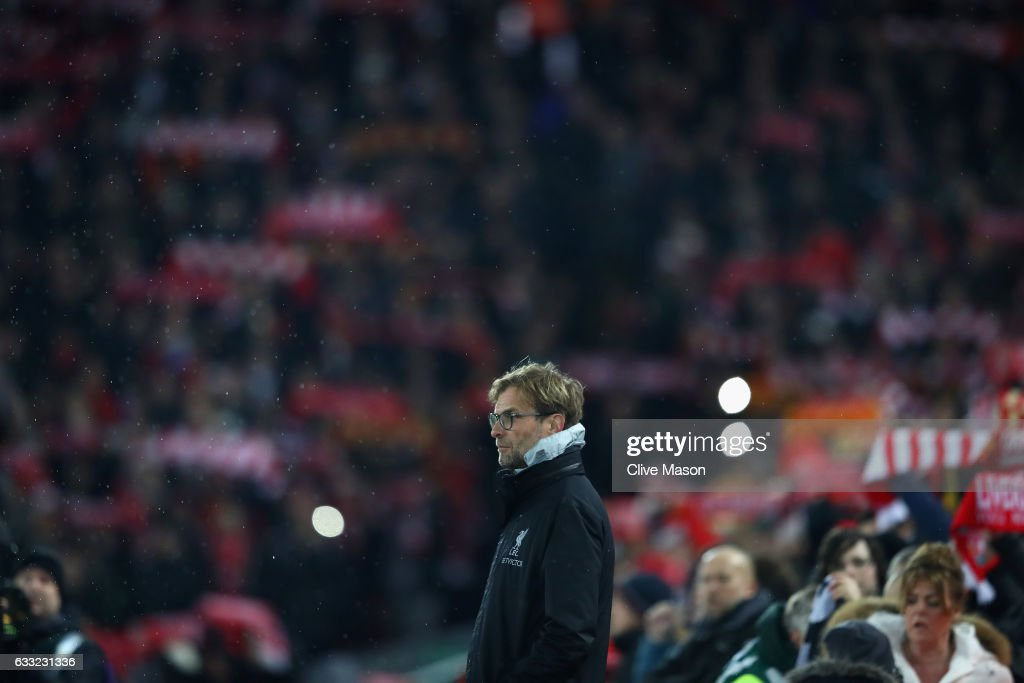 Jurgen Klopp, Manager of Liverpool is seen shortly before kick off during the Premier League match between Liverpool and Chelsea at Anfield on January 31, 2017 in Liverpool, England.