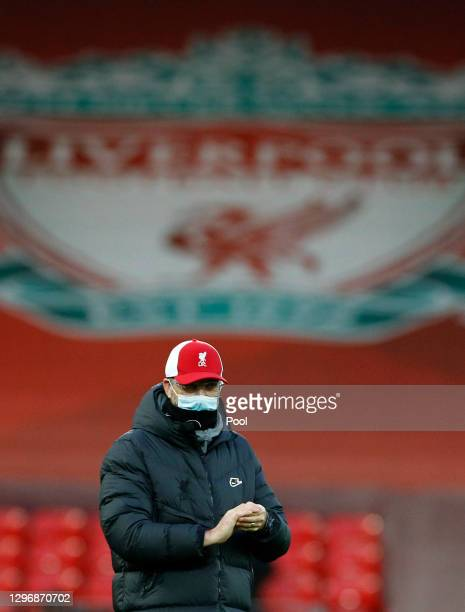 Jurgen Klopp, Manager of Liverpool is seen wearing a face mask ahead of the Premier League match between Liverpool and Manchester United at Anfield...