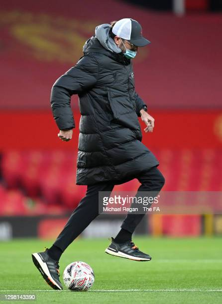 Jurgen Klopp, Manager of Liverpool is seen wearing a face mask ahead of The Emirates FA Cup Fourth Round match between Manchester United and...
