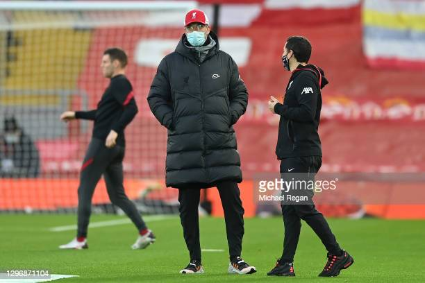 Jurgen Klopp, Manager of Liverpool is seen wearing a face mask as he watches his team warm up ahead of the Premier League match between Liverpool and...