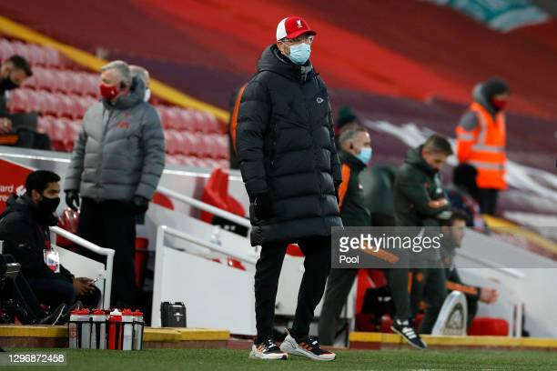 Jurgen Klopp, Manager of Liverpool is seen wearing a facemask prior to the Premier League match between Liverpool and Manchester United at Anfield on...