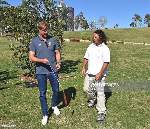 Jurgen Klopp manager of Liverpool is shown the bullroare by Clarence Slockee during a Aboriginal culture tour on Walumil Lawn on May 25 2017 in...