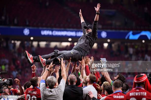 Jurgen Klopp Manager of Liverpool is thrown in the air as he celebrates with his players and staff after winning the UEFA Champions League Final...