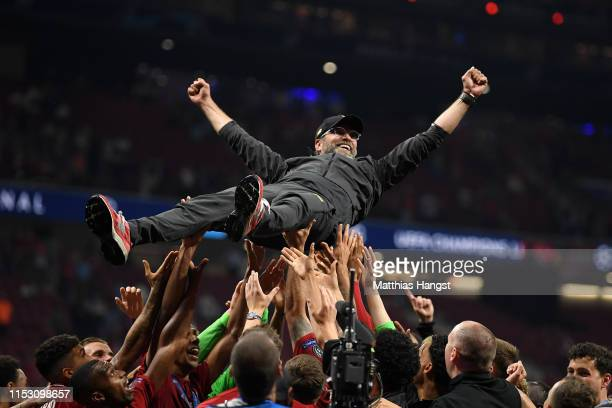 Jurgen Klopp, Manager of Liverpool is thrown in the air as he celebrates with his players and staff after winning the UEFA Champions League Final...