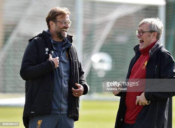 Jurgen Klopp manager of Liverpool laughing with Club photographer during a training session at Melwood training ground on March 26 2018 in Liverpool...