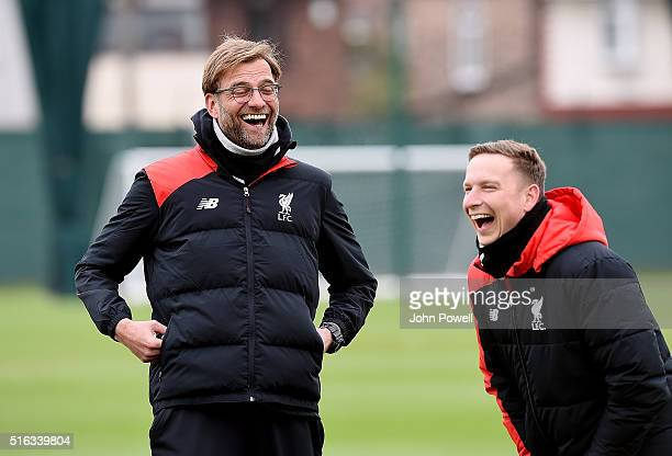 Jurgen Klopp manager of Liverpool laughing with Pepijn Lijnders first-team development coach during a training session at Melwood Training Ground on...