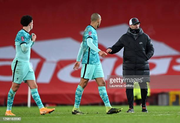 Jurgen Klopp, Manager of Liverpool looks dejected with Curtis Jones and Fabinho of Liverpool following The Emirates FA Cup Fourth Round match between...