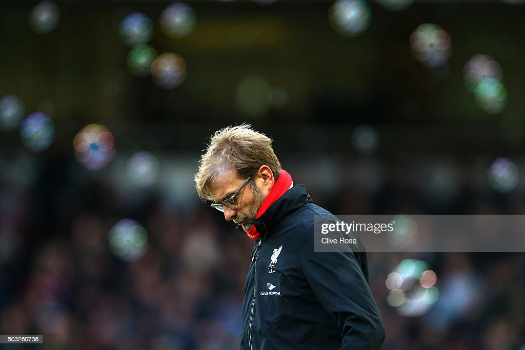 Jurgen Klopp, manager of Liverpool looks on after opposition team West Ham score their second goal during the Barclays Premier League match between West Ham United and Liverpool at Boleyn Ground on January 2, 2016 in London, England.