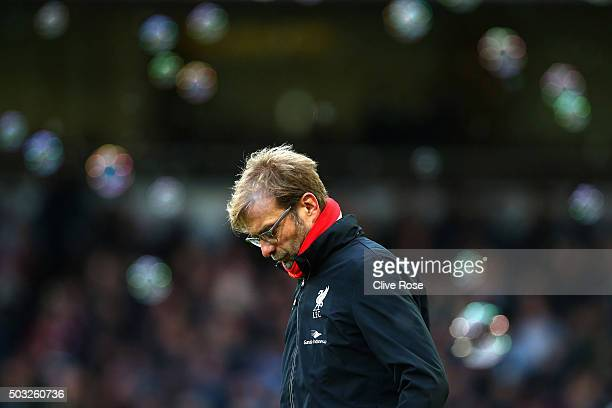 Jurgen Klopp manager of Liverpool looks on after opposition team West Ham score their second goal during the Barclays Premier League match between...