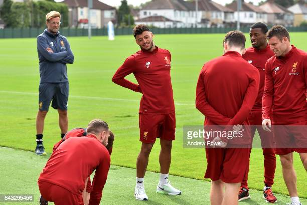 Jurgen Klopp manager of Liverpool looks on as Alex Oxlade Chamberlain of Liverpool attends his first training session Melwood Training Ground on...