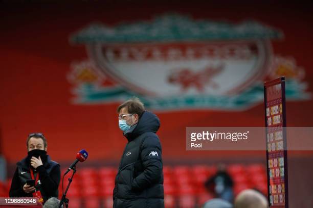 Jurgen Klopp, Manager of Liverpool looks on as he is interviewed ahead of the Premier League match between Liverpool and Manchester United at Anfield...