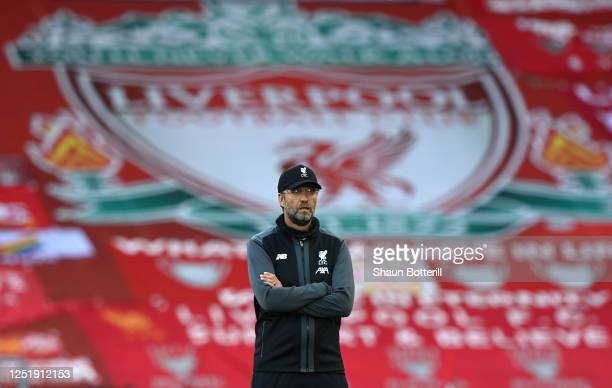 Jurgen Klopp Manager of Liverpool looks on as his team warm up ahead of the Premier League match between Liverpool FC and Crystal Palace at Anfield...