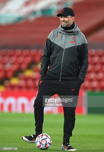 Jurgen Klopp Manager of Liverpool looks on as his team warms up ahead of the UEFA Champions League Group D stage match between Liverpool FC and FC...