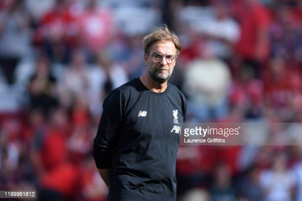 Jurgen Klopp Manager of Liverpool looks on prior to the Premier League match between Liverpool FC and Arsenal FC at Anfield on August 24 2019 in...