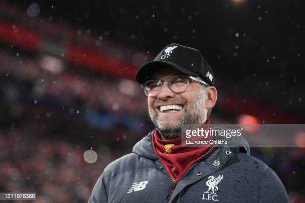Jurgen Klopp, Manager of Liverpool looks on with a smile ahead of the UEFA Champions League round of 16 second leg match between Liverpool FC and...