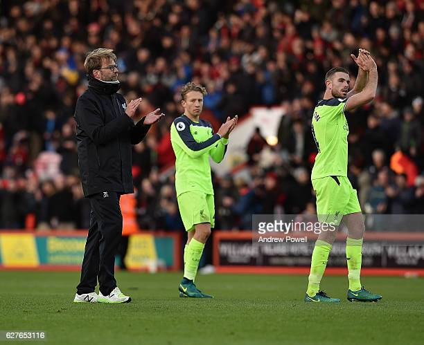 Jurgen Klopp manager of Liverpool Lucas Leiva and Jordan Henderson shows their appreciation to the fans at the end of the Premier League match...