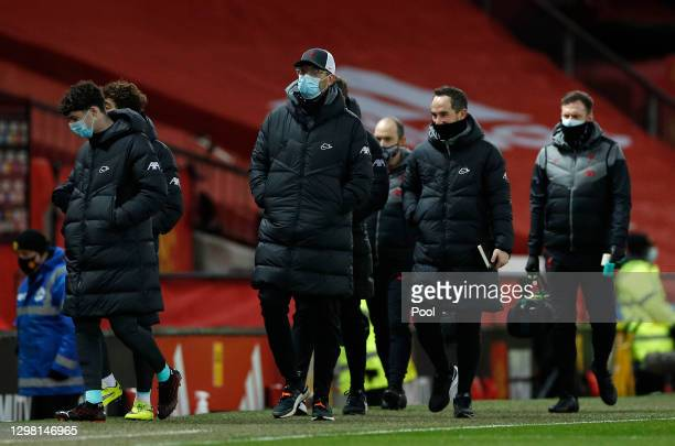 Jurgen Klopp, Manager of Liverpool makes their way towards the dugout area ahead of The Emirates FA Cup Fourth Round match between Manchester United...