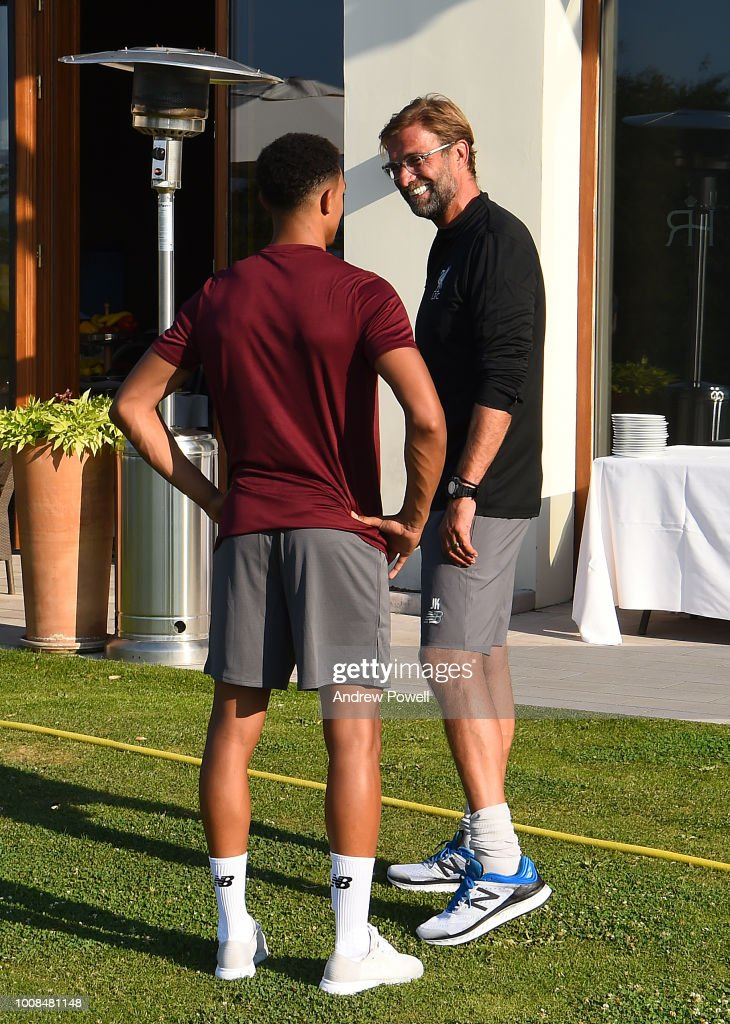Jurgen Klopp manager of Liverpool meeting Trent Alexander-Arnold of Liverpool on his first day back from international duty to join the pre-season training camp on July 31, 2018 in Evian-les-Bains, France.