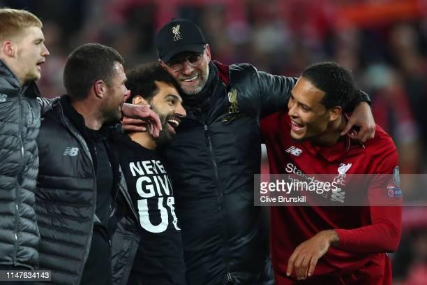 Jurgen Klopp Manager of Liverpool Mohamed Salah of Liverpool and Virgil van Dijk celebrate after the UEFA Champions League Semi Final second leg...