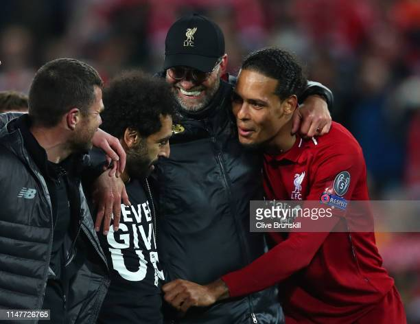 Jurgen Klopp Manager of Liverpool Mohamed Salah of Liverpool and Virgil van Dijk celebrate after the UEFA Champions League Semi Final second leg...