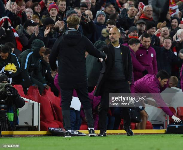 Jurgen Klopp manager of Liverpool Pep Guardiola manager Manchester City during the UEFA Champions League Quarter Final Leg One match between...
