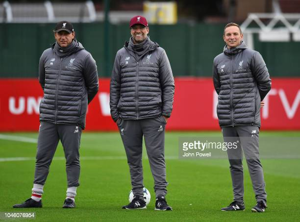 Jurgen Klopp manager of Liverpool Pepijn Lijnders and Peter Krawietz second assistant coach of Liverpool during a training session at Melwood...