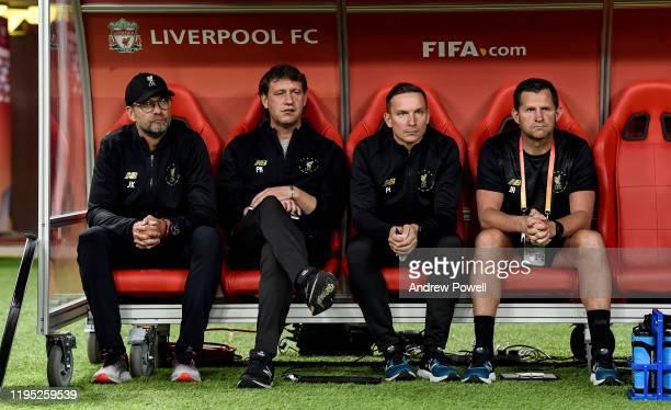 Jurgen Klopp manager of Liverpool Peter Krawietz and Pepijn Lijnders first team coaches and John Achterberg goal keeping coach during the FIFA Club...