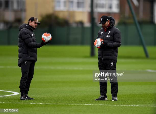 Jurgen Klopp manager of Liverpool Peter Krawietz assistant manager during a training session at Melwood Training Ground on February 21, 2020 in...