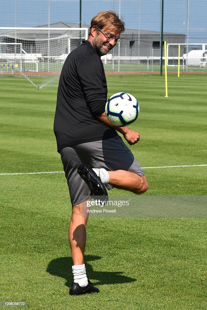 Jurgen Klopp manager of Liverpool playing football a training session on July 31, 2018 in Evian-les-Bains, France.