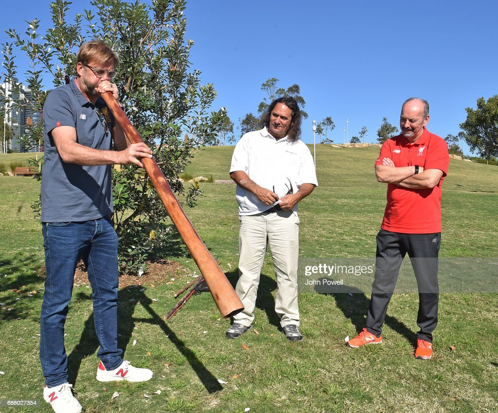 Jurgen Klopp manager of Liverpool plays the didgeridoo during a Aboriginal culture tour on Walumil Lawn on May 25, 2017 in Sydney, Australia.