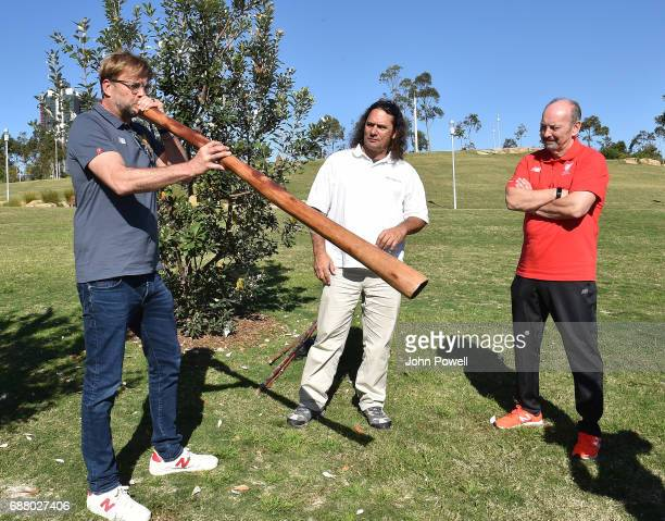 Jurgen Klopp manager of Liverpool plays the didgeridoo during a Aboriginal culture tour on Walumil Lawn on May 25 2017 in Sydney Australia