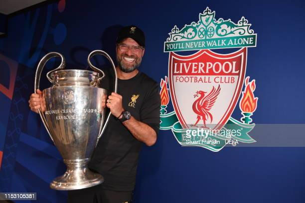 Jurgen Klopp Manager of Liverpool poses with the Champions League Trophy after winning the UEFA Champions League Final between Tottenham Hotspur and...