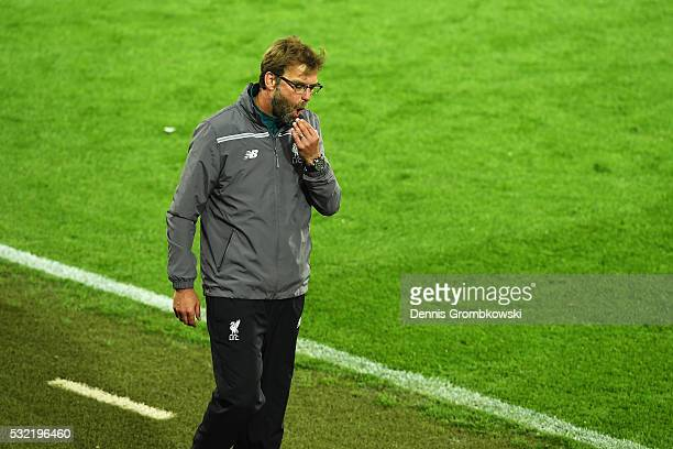 Jurgen Klopp manager of Liverpool reacts after Sevilla's third goal during the UEFA Europa League Final match between Liverpool and Sevilla at St...