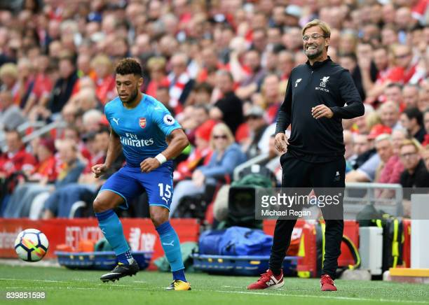 Jurgen Klopp Manager of Liverpool reacts as Alex OxladeChamberlain of Arsenal controls the ball during the Premier League match between Liverpool and...